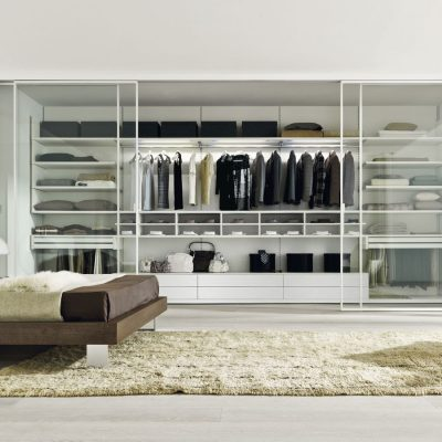 Beautiful-White-Bedroom-with-Walk-in-Closet-and-Sliding-Glass-Door-and-White-Rug
